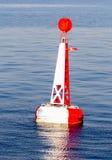 Κόκκινος άσπρος δεμένος σημαντήρας Στοκ Φωτογραφίες