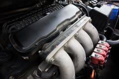 Κόκκινος εγχυτήρας LPG με τη μηχανή Στοκ Εικόνα