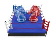 Κόκκινος και μπλε ιππότης σκακιού που αντιμετωπίζει στο εγκιβωτίζοντας δαχτυλίδι Στοκ εικόνα με δικαίωμα ελεύθερης χρήσης