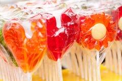 Κόκκινος και πορτοκάλι lollipops στοκ εικόνα