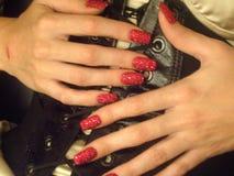 Κόκκινος - καυτά καρφιά Bedazzled στοκ εικόνα