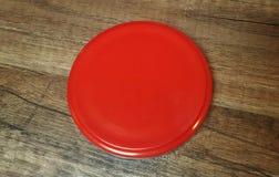 Κόκκινος κύκλος σε ένα ξύλινο υπόβαθρο Στοκ φωτογραφίες με δικαίωμα ελεύθερης χρήσης