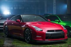 Κόκκινος-μαύρος συντονισμός της Nissan GT-ρ Στοκ εικόνα με δικαίωμα ελεύθερης χρήσης