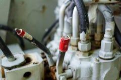 Κόκκινος μοχλός στη βιομηχανική μηχανή Στοκ εικόνες με δικαίωμα ελεύθερης χρήσης
