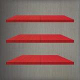 3 κόκκινος ξύλινος πίνακας ραφιών Στοκ Εικόνες