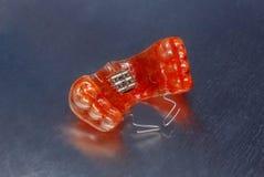 Κόκκινος οδοντικός στηρίγματα ή υπηρέτης για τα δόντια στο υπόβαθρο metall Στοκ Εικόνες