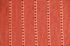 κόκκινος πίνακας καρδιών υφασμάτων Στοκ Φωτογραφία