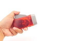 Κόκκινος πλαστικός κάτοχος φακών των οδηγήσεων συμπίεσης χεριών με το σχοινί χεριών Στοκ εικόνα με δικαίωμα ελεύθερης χρήσης