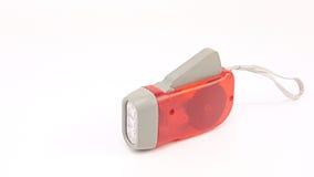 Κόκκινος πλαστικός κάτοχος φακών των οδηγήσεων συμπίεσης χεριών με το σχοινί χεριών Στοκ φωτογραφία με δικαίωμα ελεύθερης χρήσης