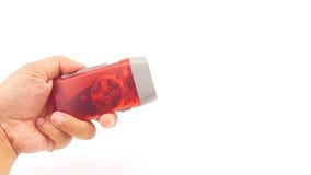 Κόκκινος πλαστικός κάτοχος φακών των οδηγήσεων συμπίεσης χεριών με το σχοινί χεριών Στοκ φωτογραφίες με δικαίωμα ελεύθερης χρήσης