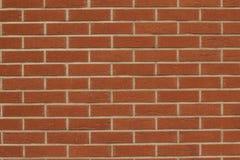 κόκκινος τοίχος τεμαχίων Στοκ Φωτογραφίες