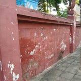 Κόκκινος τοίχος τσιμέντου Στοκ Φωτογραφία