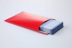 Κόκκινος φάκελος με τα χρήματα Στοκ Εικόνα