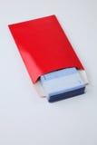 Κόκκινος φάκελος με τα χρήματα Στοκ Φωτογραφίες