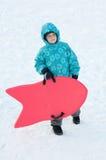 κόκκινος χειμώνας ελκήθρων αγοριών Στοκ Φωτογραφίες