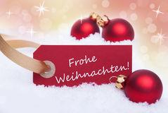 Κόκκινο έμβλημα με Frohe Weihnachten Στοκ Εικόνες