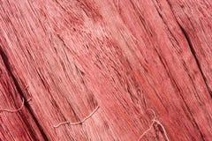 Κόκκινο ακατέργαστο υπόβαθρο νημάτων μεταξιού Στοκ Εικόνες