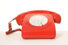 κόκκινο αναδρομικό τηλέφωνο Στοκ Φωτογραφία