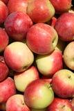 κόκκινο ανασκόπησης μήλων Στοκ Φωτογραφίες