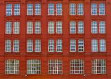 κόκκινο ανύψωσης οικοδόμ Στοκ Φωτογραφία