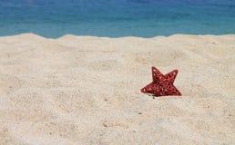 Κόκκινο αστέρι στην άμμο Στοκ Εικόνα