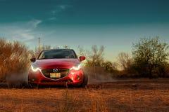 Κόκκινο αυτοκίνητο που ολισθαίνει στο έδαφος Στοκ Εικόνα