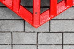 Κόκκινο βέλος στο δρόμο Στοκ Εικόνες