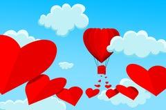 Κόκκινο, διαμορφωμένο καρδιά μπαλόνι ζεστού αέρα με το ίχνος καρδιών πίσω Στοκ Εικόνες