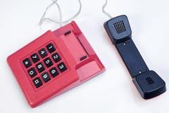 Κόκκινο εκλεκτής ποιότητας τηλέφωνο Στοκ Εικόνες