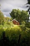 κόκκινο εξοχικών σπιτιών Στοκ Φωτογραφία