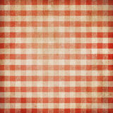 Κόκκινο ελεγχμένο grunge gingham τραπεζομάντιλο πικ-νίκ Στοκ φωτογραφία με δικαίωμα ελεύθερης χρήσης