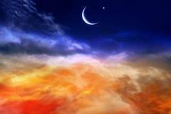 Κόκκινο ηλιοβασίλεμα και φεγγάρι Στοκ εικόνα με δικαίωμα ελεύθερης χρήσης