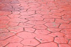 Κόκκινο ισόγειο τσιμέντου ενός πεζοδρομίου στοκ φωτογραφία