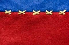 Κόκκινο και αισθητό μπλε ύφασμα Στοκ φωτογραφία με δικαίωμα ελεύθερης χρήσης