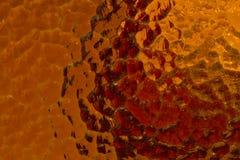 Κόκκινο και ζαρωμένο πορτοκάλι γυαλί Στοκ φωτογραφία με δικαίωμα ελεύθερης χρήσης