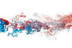 Κόκκινο και μπλε μελάνι Στοκ Φωτογραφίες
