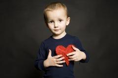 κόκκινο καρδιών αγοριών Στοκ Εικόνες