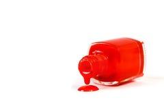 Κόκκινο καρφί στίλβωση που ανατρέπεται που απομονώνεται στο άσπρο υπόβαθρο Στοκ Εικόνες