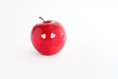 Κόκκινο καλό μήλο με τα μάτια καρδιών Στοκ φωτογραφία με δικαίωμα ελεύθερης χρήσης
