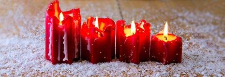 Κόκκινο κερί Χριστουγέννων τέσσερα για την εμφάνιση Στοκ Εικόνα