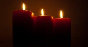 κόκκινο κεριών καψίματος Στοκ Εικόνες