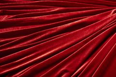 Κόκκινο κλωστοϋφαντουργικό προϊόν βελούδου για το υπόβαθρο ή τη σύσταση Στοκ Εικόνες