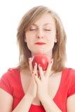 κόκκινο κοριτσιών μήλων Στοκ φωτογραφίες με δικαίωμα ελεύθερης χρήσης
