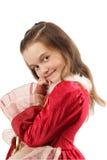 κόκκινο κοριτσιών φορεμά&tau Στοκ Φωτογραφίες