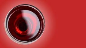 κόκκινο κρασί γυαλιού στο υπόβαθρο χρώματος Στοκ Εικόνες