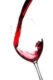 κόκκινο κρασί παφλασμών Στοκ Εικόνες