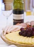 κόκκινο κρασί πρόχειρων φαγητών συμβαλλόμενων μερών Στοκ Φωτογραφία