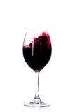 Κόκκινο κρασί σε ένα γυαλί κρασιού που απομονώνεται στο λευκό Στοκ Εικόνα