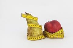 Αχλάδι της Apple και ταινία μέτρησης Στοκ Φωτογραφία