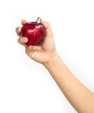 Κόκκινο μήλο σε ετοιμότητα γυναικείο Στοκ Φωτογραφίες
